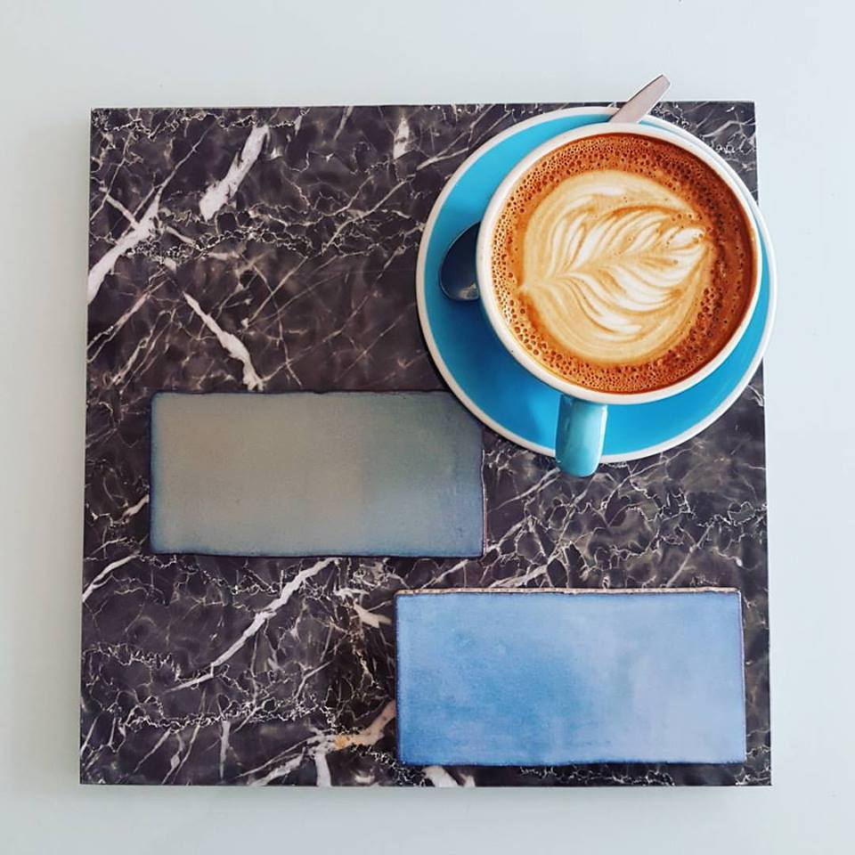 Dark Emperador marble and stunning hand cut Spanish subway tiles in dreamy blues