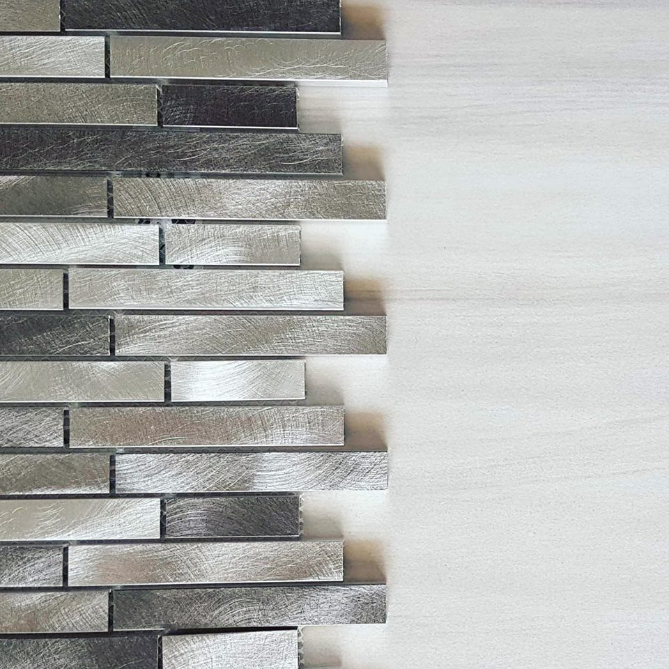 Brushed metal mosaic brings the bling; something different for a creative twist to your space.