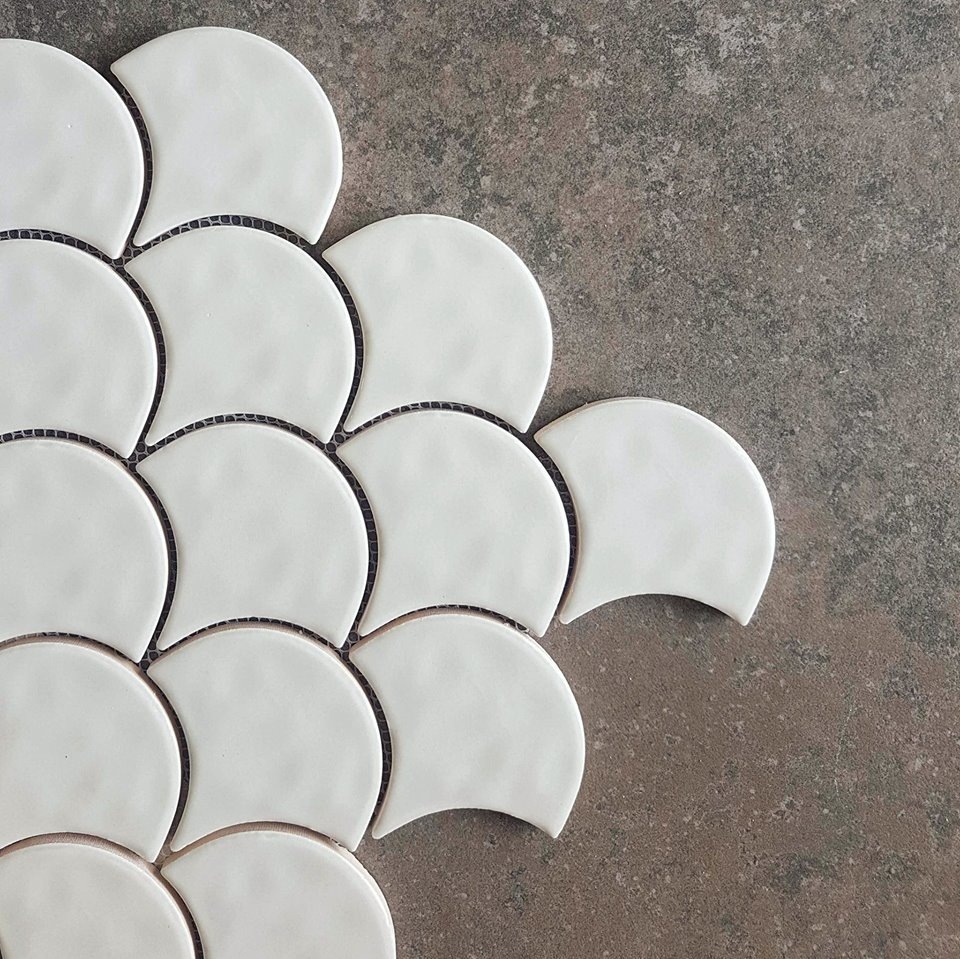 Totally touchable fishscale teamed with a dramatic stone-look large format tile.