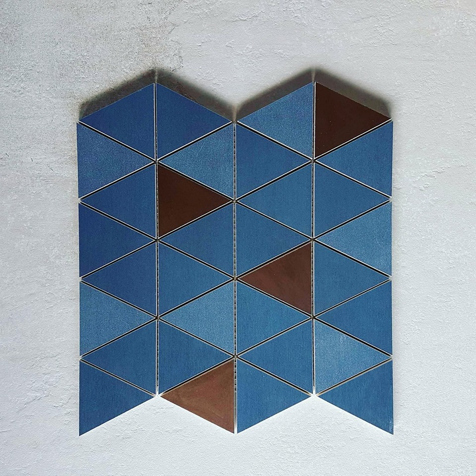 Geometry and glamour collide in these Italian-made metallic wall tiles, pictured here in a show-stopping combination of blue and bronze.